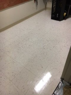 VCT tiled floor after receiving a strip and wax