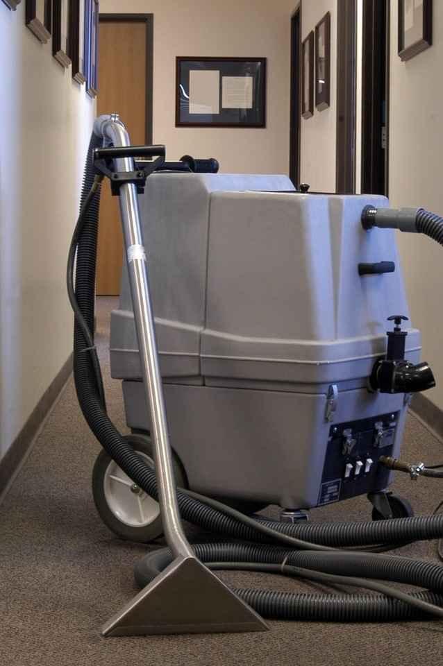 Carpet steam cleaning machine.
